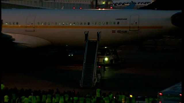 Manchester United arrive back from Moscow More various of disembarking steps rolled into place and attached to plane entrance