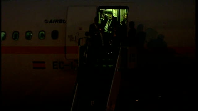 Manchester United arrive back from Moscow More of silhouettes of Manchester United FC team down plane steps SOTMembers of Manchester United team hold...