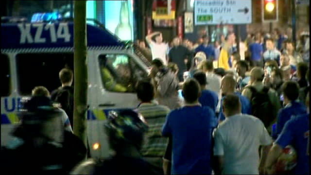 Manchester United arrive back from Moscow TX Rangers fans attacking police van