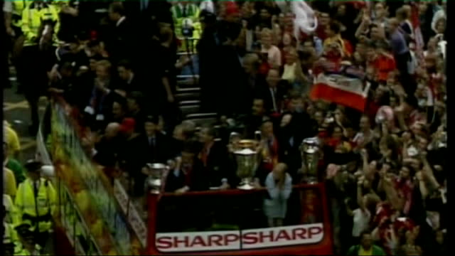 manchester united arrive back from moscow tx 2751999 manchester united parade on opentop bus with football trophies - final round stock videos & royalty-free footage