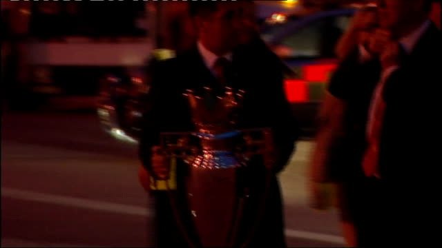 manchester united arrive back from moscow manchester united team standing next bus with trophies - final round stock videos & royalty-free footage