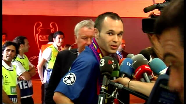 Final postmatch shots from mixed zone ITALY Rome Stadio Olimpico INT Sir Alex Ferguson walks past cameras Andres Iniesta talking to press Samuel...
