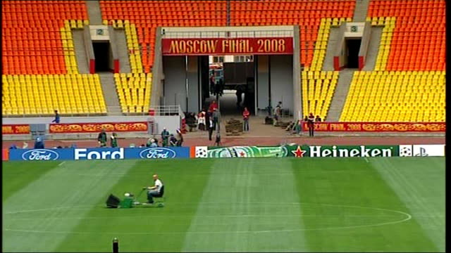 worries about pitch condition at luzhniki stadium russia moscow luzhniki stadium ext shots of matt frost along sidelines and using lawnmower on... - luzhniki stadium stock videos & royalty-free footage