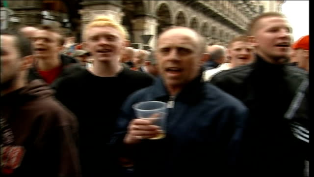 manchester united lose in semifinal italy milan ext manchester united supporters holding drinks and chanting holding up manchester united banner and... - neckwear stock videos and b-roll footage