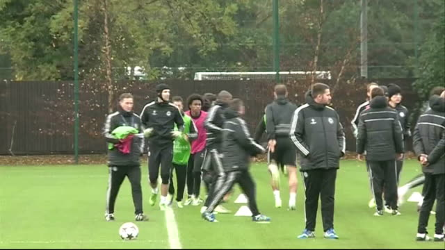 surrey cobham training ground chelsea fc ext chelsea footballers warming up at training session - cobham surrey stock videos and b-roll footage