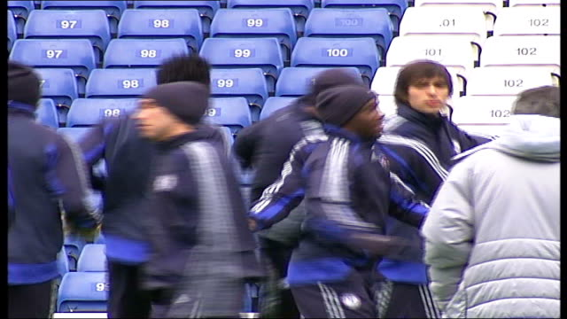 Champions League Quarter Final matches EXT **Cech interview overlaid SOT** Chelsea players warming up during training session including Didier Drogba...