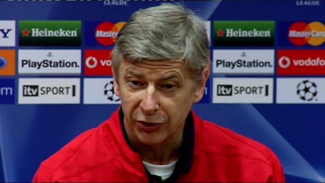 int arsene wenger press conference sot jokes about sound of liverpool fans at anfield - アーセン・ベンゲル点の映像素材/bロール