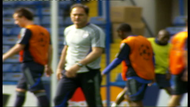 chelsea v liverpool ext jose mourinho watching chelsea squad stretching during training session - semifinal round stock videos & royalty-free footage