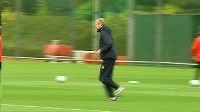 semifinals ENGLAND Hertfordshire London Colney EXT General views Arsenal FC training session including shot of Arsene Wenger kicking ball