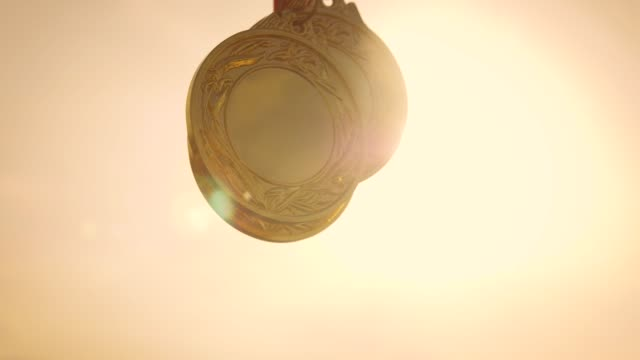 championship medals with sunlight - gold medal stock videos & royalty-free footage
