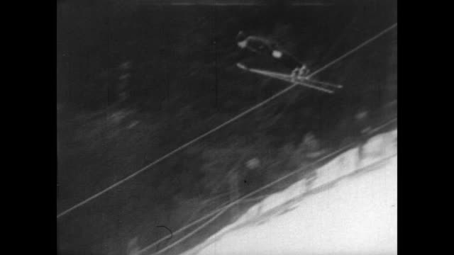 championship ski jump in norway / small crowd scattered along slope / cu bjørn wirkola as he makes his jump / soars through the air gracefully / man... - nordic skiing event stock videos and b-roll footage