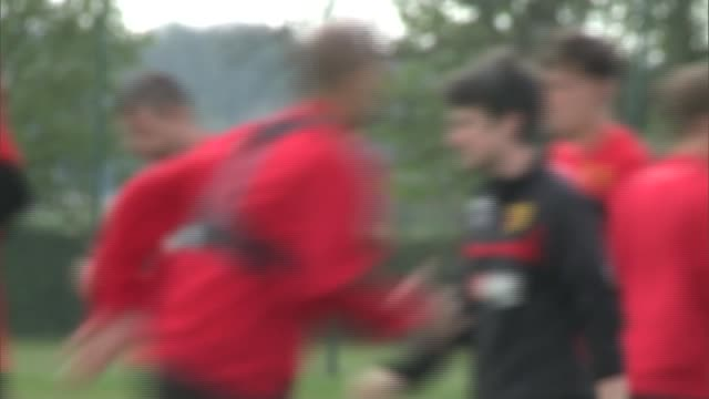 Watford close to promotion to Premier League **MUSIC OVERLAY Pink Floyd 'Money'** Various OUT OF FOCUS shots of Watford FC players training on...