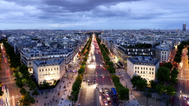 champs-élysées night time lapse in paris france - france stock videos & royalty-free footage