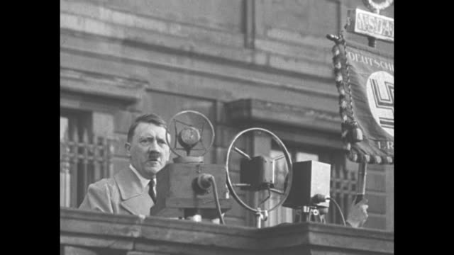 vídeos de stock, filmes e b-roll de chancellor adolf hitler speaking from balcony at brown shirt rally - adolf hitler