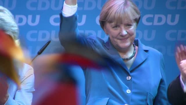 chancellor angela merkel clinched a surprise absolute majority in her winning bid for a third term in german elections sunday estimates on public... - angela merkel stock videos & royalty-free footage