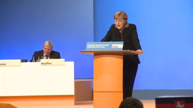 chancellor angela merkel kicked off her bid for a third term tuesday saying only she could steer germany through turbulent times and touting her... - gebot stock-videos und b-roll-filmmaterial