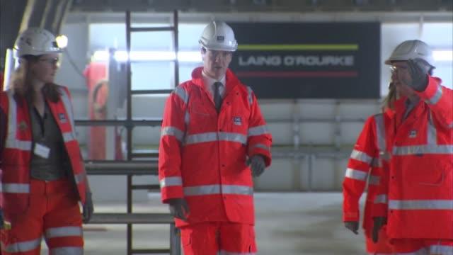 chancellor george osborne and transport secretary patrick mcloughlin visit crossrail project at tottenham court road; england: london: tottenham... - tottenham court road stock videos & royalty-free footage