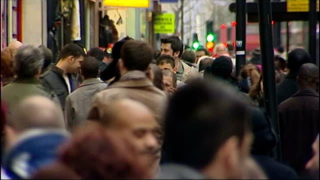 Chancellor George Osborne delivers Autumn Statement Crowds of shoppers / pedestrians along Oxford Street