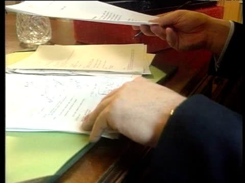 vídeos y material grabado en eventos de stock de chancellor gordon brown sitting at desk with red budget box london; 6 may 1997 - postura