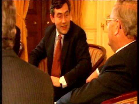 chancellor gordon brown talks with baron george and bank of england governor mervyn king - crisis stock videos & royalty-free footage