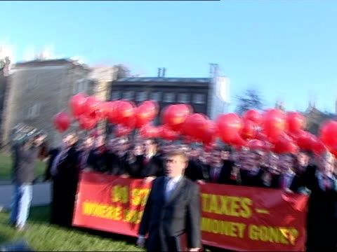 chancellor gordon brown with red budget case outside number 11 / gordon brown balloon protest by tories mark francois mp speaks to press sot /... - number 11 stock videos and b-roll footage