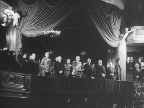 chancellor hitler in suit standing w/ president of germany paul von hindenburg in full uniform others in theatre balcony tu ws hitler standing next... - chancellor stock videos & royalty-free footage