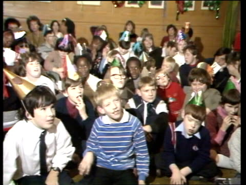 chancellor nigel lawson plays father christmas; england: london: downing street: number 11: int tms children sitting on floor cms boy little girl... - paul daniels stock videos & royalty-free footage