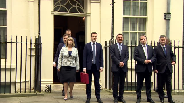chancellor of the exchequer george osborne and fellow mps line up on downing street as he holds up the budget box - chancellor of the exchequer stock videos and b-roll footage