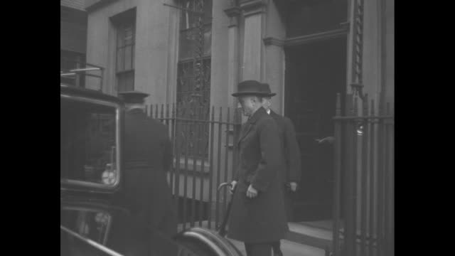 chancellor of the exchequer neville chamberlain and former secretary of state sir samuel hoare leave 10 downing street during the abdication crisis... - chancellor of the exchequer stock videos and b-roll footage