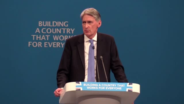 chancellor of the exchequer philip hammond discusses brexit during his speech at at the conservative party conference in manchester - chancellor of the exchequer stock videos and b-roll footage