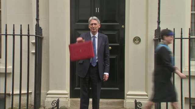 Chancellor of the Exchequer Philip Hammond holding the Budget Box outside 11 Downing Street