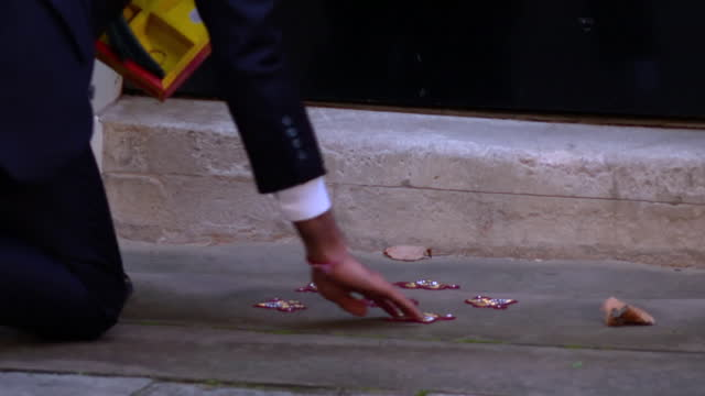 chancellor of the exchequer rishi sunak laying down diya's for diwali outside 11 downing street - traditional festival stock videos & royalty-free footage