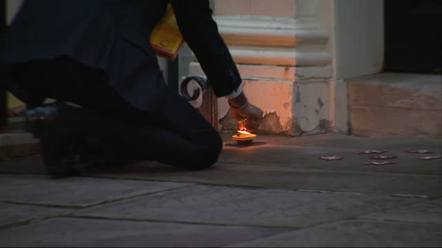 chancellor of the exchequer rishi sunak lighting diya's outside downing street for diwali - south asia stock videos & royalty-free footage