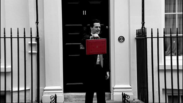 chancellor promises tax avoidance crackdown 22610 downing street shots of george osborne mp outside no11 holding up red budget box - avoidance stock videos & royalty-free footage