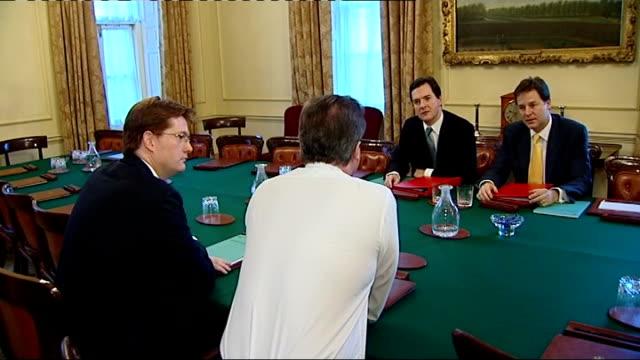 stockvideo's en b-roll-footage met chancellor promises tax avoidance crackdown lib / cameron alexander osborne and clegg sitting at cabinet table osborne and clegg - vermijden