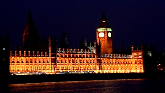 chancellor reveals child benefit records security breach; ext / night good shot of floodlit palace of westminster against night sky from across river... - floodlit stock videos & royalty-free footage