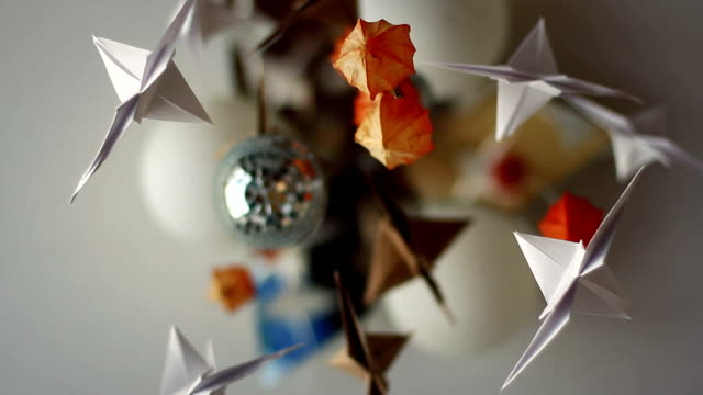 chandelier with paper cranes - folding paper stock videos and b-roll footage