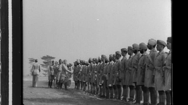 stockvideo's en b-roll-footage met chandra bose the supreme commander of the provisional government of free india presents an award to major missler of the indian national army ina... - slagfront