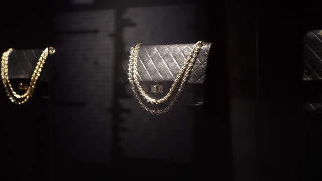 """chanel 2.55 black leather quilted bags are seen, during the """"gabrielle chanel - manifeste de mode"""" exhibition, during the picto awards 2020 at palais... - bag stock videos & royalty-free footage"""