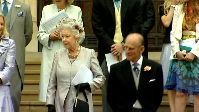 Changes approved to British royal succession rules LIB Windsor St George's Chapel EXT Peter Phillips down steps of chapel with bride Autumn Kelly...