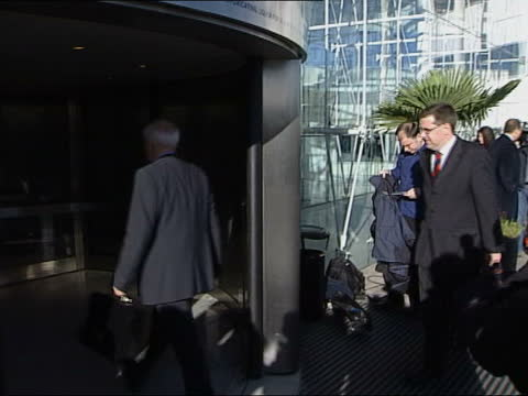changes to formula one announced: meeting arrivals; england: london: heathrow airport: ext tv cameraman from car / man arriving at hotel holding... - formula one racing stock videos & royalty-free footage