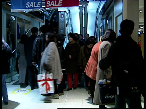 vídeos de stock, filmes e b-roll de changes to labour laws part 1 int customers shopping in department store / woman trying on outfit looking in mirror and chatting to sales assistants... - giorgio armani marca de moda