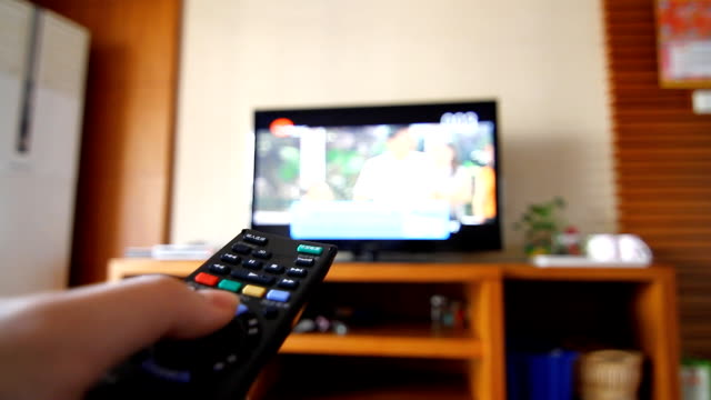 changing channels with remote controller - television show stock videos & royalty-free footage