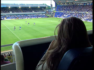 """vidéos et rushes de changing face of football; itn england: birmingham: st andrews: women & children in crowd pull out """"family stand"""" sign above cbv fans as game in... - respect"""