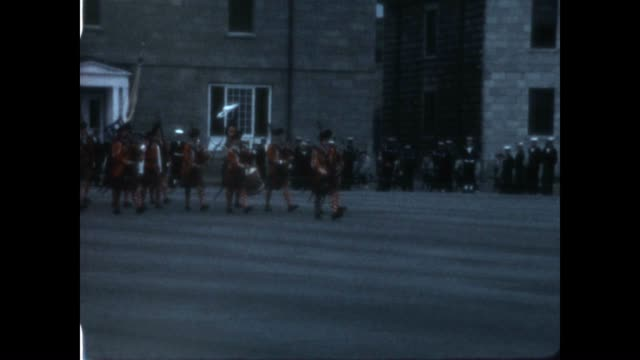 changing of the guard at the citadelle of quebec in the late 1960's from a home movie collection featuring a scottish dance. - scottish culture bildbanksvideor och videomaterial från bakom kulisserna
