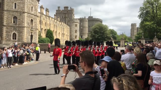 vídeos de stock e filmes b-roll de changing of the guard takes place outside windsor castle in windsor ahead of the royal christening of the duke and duchess of sussex's son archie in... - duke of sussex