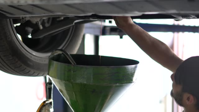 changing oil in auto repair garage. - motor oil stock videos & royalty-free footage