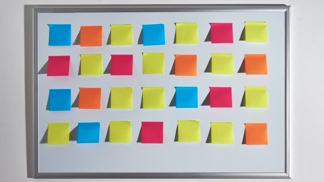changing pattern of colorful sticky notes. - adhesive note stock videos & royalty-free footage