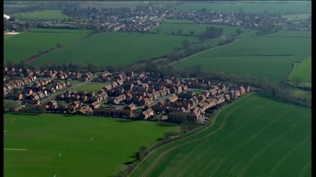 changing role of national trust; lib / t27031243 unidentified location: air views / aerials housing estates surrounded by green fields - national trust video stock e b–roll
