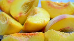 Changing the focus point with a plate of ripe sliced peach, soft focus